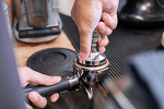 tamping coffee when making espresso